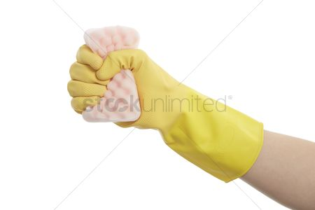 Grasp : Hand with glove squeezing a kitchen sponge