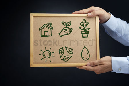 Cork board : Hands holding a board with ecology concept