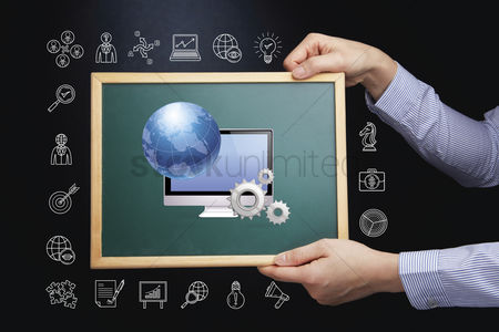 Sales person : Hands holding chalkboard with global business concept