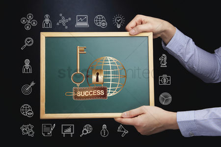 Sales person : Hands holding chalkboard with key to success concept
