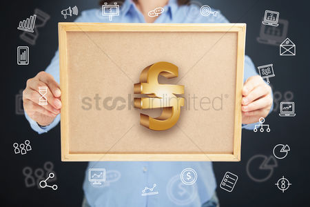 Cork board : Hands presenting hryvnia currency symbol on cork board concept