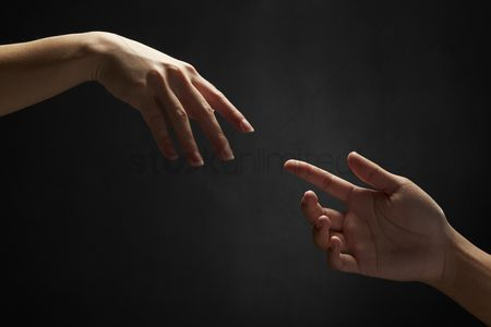Two people : Hands reaching out to one another
