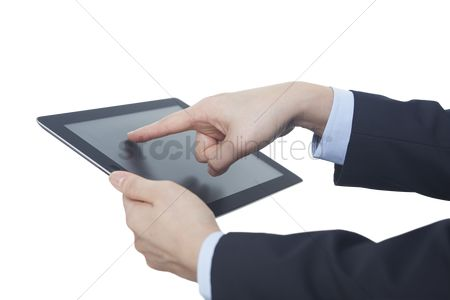 Devices : Hands using a digital tablet