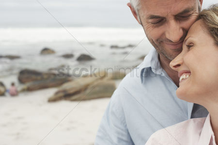 Head shot : Happy couple on beach