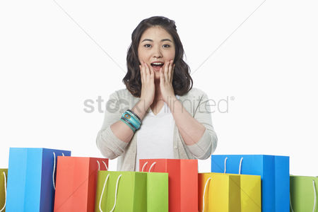 Excited : Happy woman with a surprised facial expression