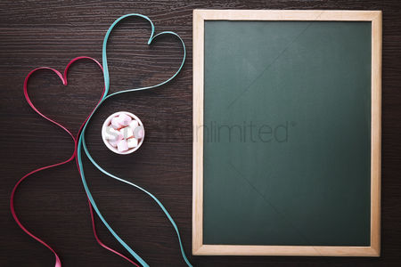 Flat : Heart shaped ribbon with marshmallows and blackboard