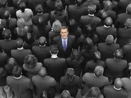 Business : High angle view of a businessman standing amidst businesspeople