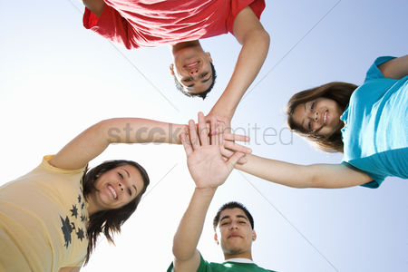 School : High school students touching hands