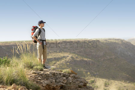 Contemplation : Hiker standing on top of mountain