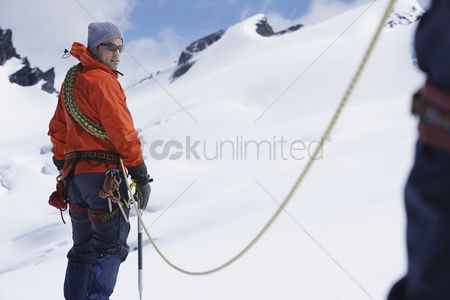 Rope : Hikers joined by safety line in snowy mountains