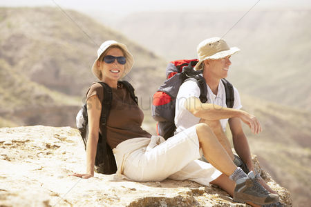 Remote : Hiking couple sitting on  mountain