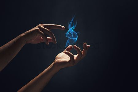 Creativity : Human hands playing with fire