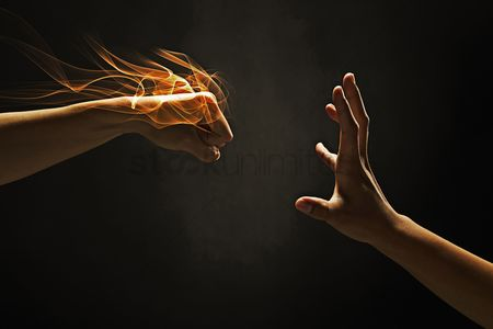 Black background : Human hands showing punching gesture