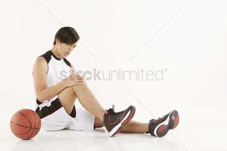 Masculinity : Injured man sitting on the floor