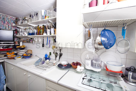 Bowl : Interior of domestic kitchen with utensils and shelves