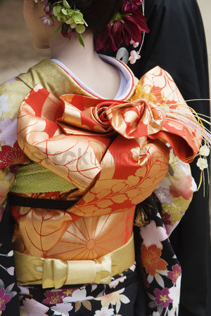 Traditional clothing : Japanese woman in kimono and elaborate obi