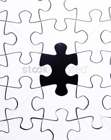 Conceptual : Jigsaw puzzle with a missing piece