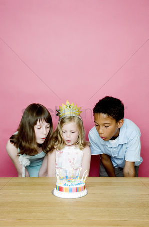 Blowing : Kids blowing the candles on the birthday cake