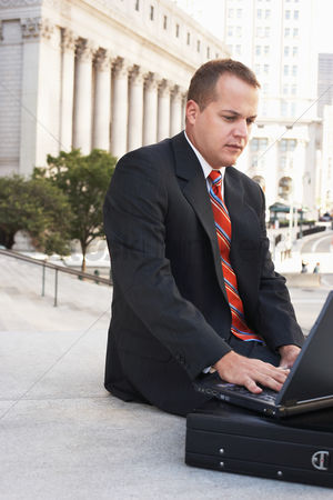 Steps : Lawyer using laptop on steps outdoors