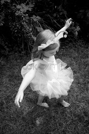 Adorable : Little girl wearing ballet dress dancing happily