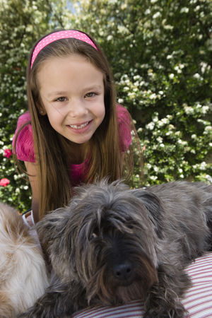 Domesticated animal : Little girl with pets