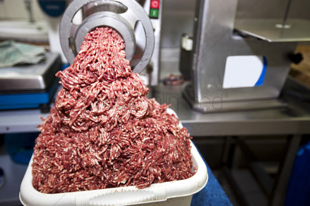 Supermarket : Machine mincing meat in grocery store