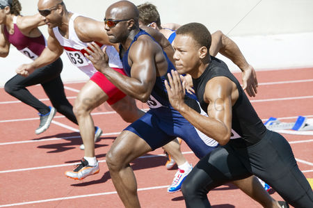 Sports : Male athletics sprinting on running track