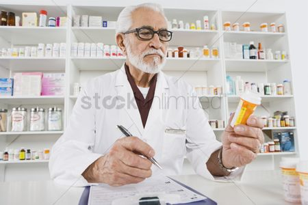 Medication : Male pharmactist working in pharmacy