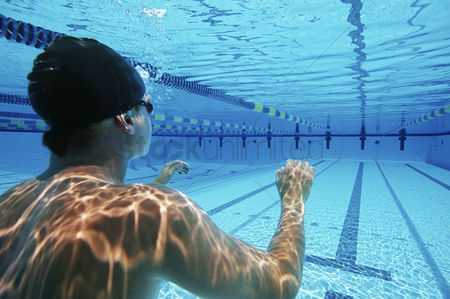 Swimmer : Male swimmer wearing united states swimming cap in pool
