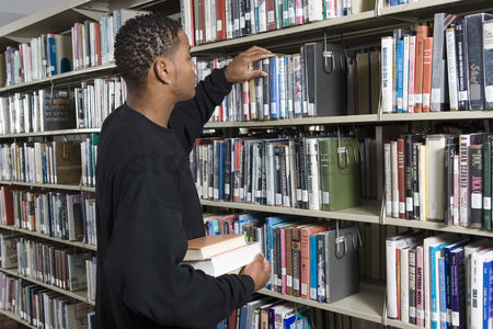 University : Male university student in library
