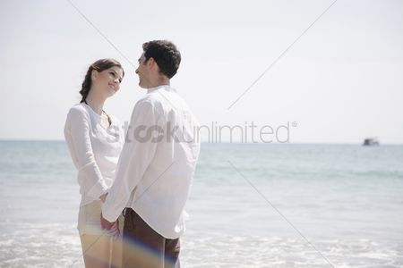 Girlfriend : Man and woman holding hands and looking at each other