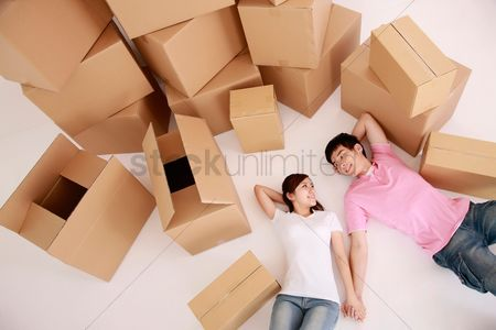 Girlfriend : Man and woman lying down with moving boxes next to them