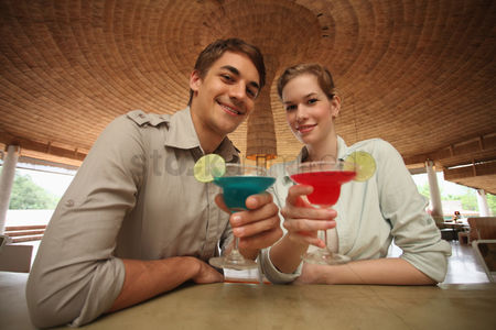 Toasting : Man and woman with their drinks