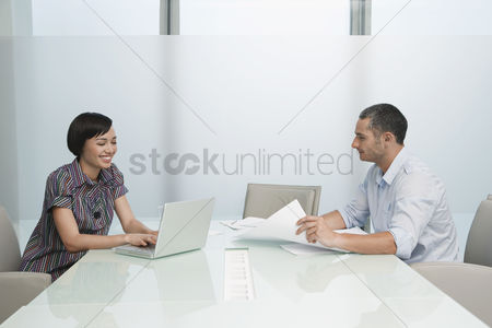 Office worker : Man and woman working in conference room woman on laptop