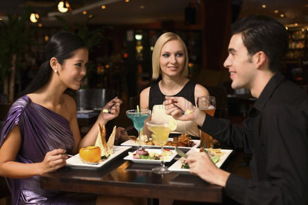 Friends : Man and women having dinner together