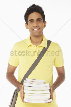 Malaysian indian : Man carrying a stack of books