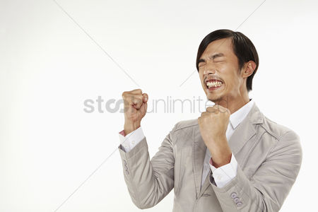 Excited : Man cheering with fists help up