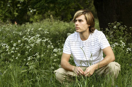 Daydream : Man daydreaming in the park