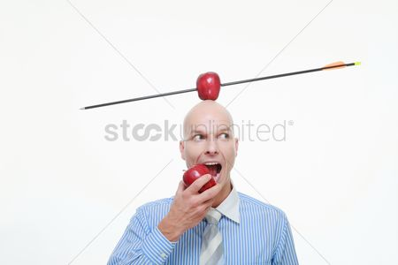 Bald : Man eating apple with apple pierced by arrow balanced on his head