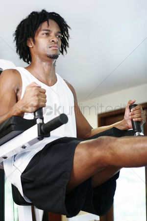 Strong : Man exercising in the gymnasium