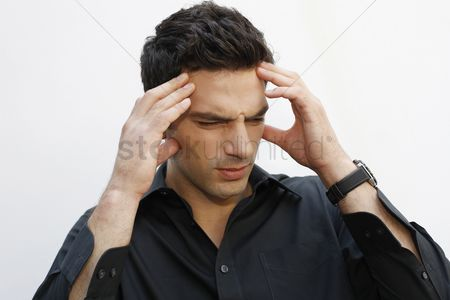 Frowning : Man frowning with hands on head