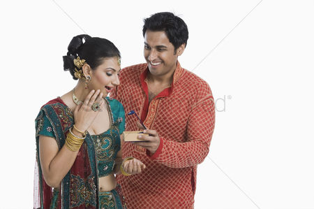 Diwali : Man giving gift to his wife on diwali