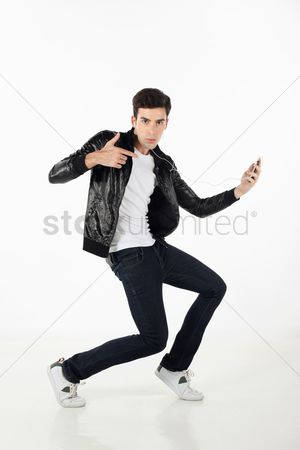 Dancing : Man grooving while listening to music on mp3 player