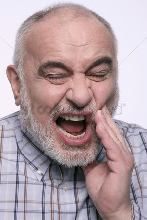 Frowning : Man having a toothache