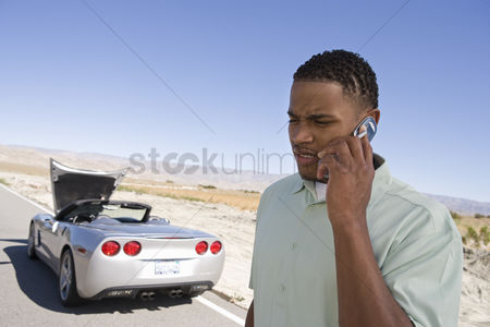 Cellular phone : Man having car trouble