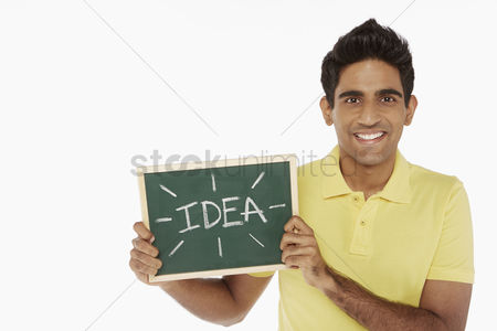 Masculinity : Man holding up a blackboard with an  idea  word on it