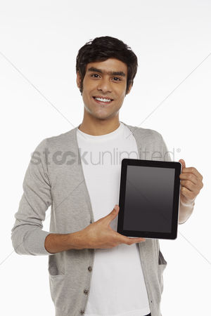 Portability : Man holding up a digital tablet