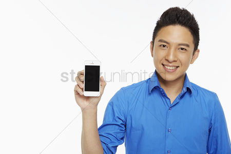 Masculinity : Man holding up a mobile phone