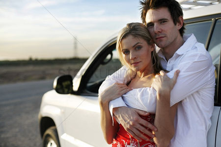Transportation : Man hugging his girlfriend from behind