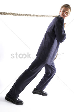 Rope : Man in business suit pulling a rope with all his might